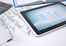 The book, calculator, paper and tablet computer Royalty Free Stock Image