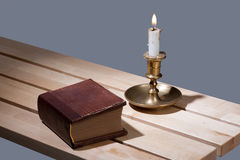 Book And Candle Stock Images