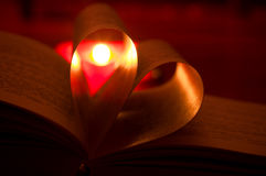 Book and candle Royalty Free Stock Images