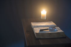 Book and candle Royalty Free Stock Photo