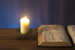 Book and candle Stock Image