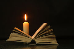 Book and candle Royalty Free Stock Photos