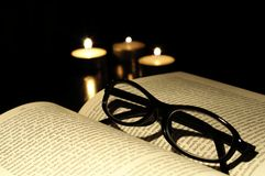 Book candle and glasses Royalty Free Stock Image