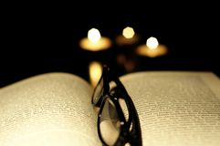 Book candle and glasses Royalty Free Stock Photography