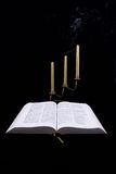 Book and candles Royalty Free Stock Photos