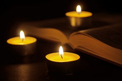 Book and candles Stock Image