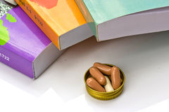 Book and  capsule pills Stock Images