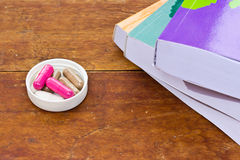 Book and  capsule pills Royalty Free Stock Photos