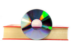 Book and cd. Book with a digital cd Royalty Free Stock Photography