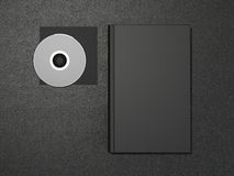 Book and CD. On the black skin Royalty Free Stock Images