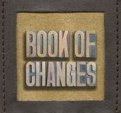 Book of changes framed. Book of changes phrase made from vintage wooden letterpress inside stitched leather frame Royalty Free Stock Image