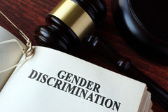 Book with chapter gender discrimination. And a gavel stock images