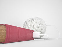 Book charging brain concept Stock Photography
