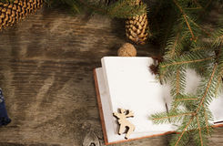 Book with Christmas decoration on the wooden rustic table Stock Photos