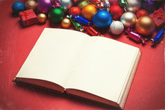Book and chritmas toys Royalty Free Stock Photography