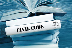 Book with Civil Code word on table in a courtroom Stock Photo