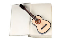 Book and classic guitar Stock Images