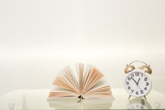 Book and clock Stock Image