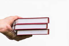 Book. Close up hand hold red books Royalty Free Stock Images