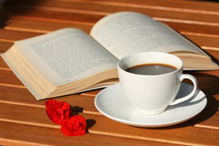Book and coffee. Cup of coffee and book. Reading in the garden Stock Photo