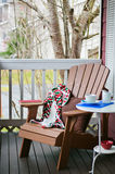 Book and Coffee on a Cozy Porch Royalty Free Stock Photo