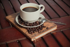 Book coffee. Cup of coffee on the book royalty free stock photo