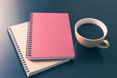 Book and coffee cup on black wooden table Royalty Free Stock Photography