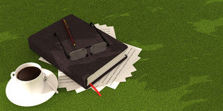 Book coffee  on green carpet Royalty Free Stock Photography