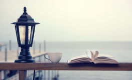 Book and coffee time by the seaside Royalty Free Stock Image