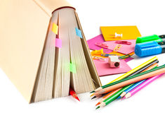 Book and colorful pencils Stock Photo