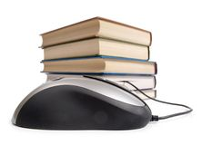 Book and computer mouse Stock Images