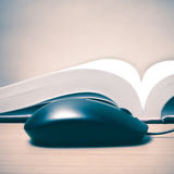 Book and computer mouse Royalty Free Stock Image