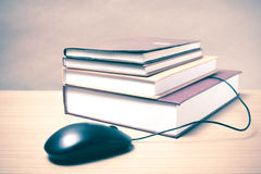Book and computer mouse Stock Photos