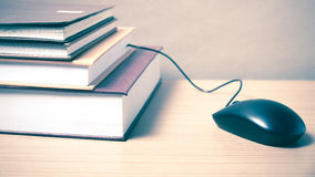 Book and computer mouse Stock Image