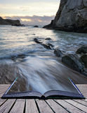 Book concept Beach sunrise landscape with long exposure waves mo Stock Photo