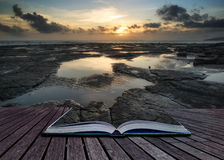 Book concept Beautiful seascape at sunset with dramatic clouds l Royalty Free Stock Images