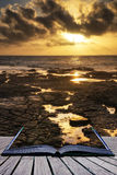 Book concept Beautiful seascape at sunset with dramatic clouds l Royalty Free Stock Photography