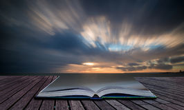 Book concept Beautiful sunset long exposure image over ocean