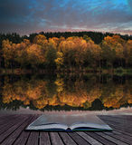 Book concept Beautiful vibrant Autumn woodland reflecions in cal Stock Photography