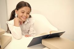 Book concept. Happy girl smile reading book. Teach yourself book. Book to change your world.  stock photos