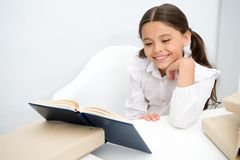 Book concept. Happy girl smile reading book. Teach yourself book. Book to change your world.  stock photography