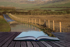 Book concept Landscape image of flooded country lane in farm Stock Image