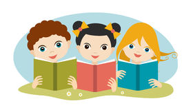 Book concept. Little cute group of three children reading a books sitting on the grass Royalty Free Stock Image