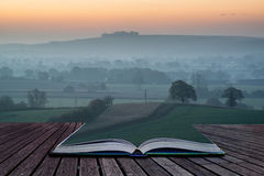 Book concept Stunning sunrise over fog layers in countryside lan Royalty Free Stock Photo