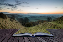 Book concept Stunning sunrise over fog layers in countryside lan Royalty Free Stock Photography