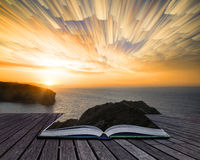 Book concept Unique abstract time lapse stack sunrise landscape. Book concept Unique time lapse stack sunrise landscape over rocky coastline Stock Photo