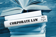 Book with Corporate Law word on table in a. Law concept - Law book with Corporate Law word on table in a courtroom or law enforcement office. Toned image stock image