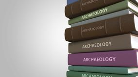 Book cover with ARCHAEOLOGY title, loopable 3D animation. Stack of books. 3D rendering royalty free illustration