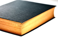 Book,cover,blur,concept. Side profile of closed book with a dark cover on white background Stock Photo