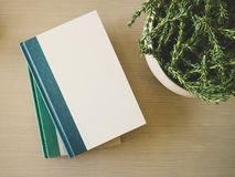 Book cover Mock up template on table with plant decoration Stock Images